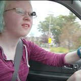 Trisha driving with optic device on her glasses