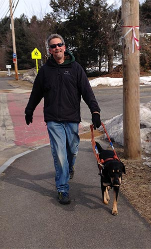Randy Pierce walking with his dog