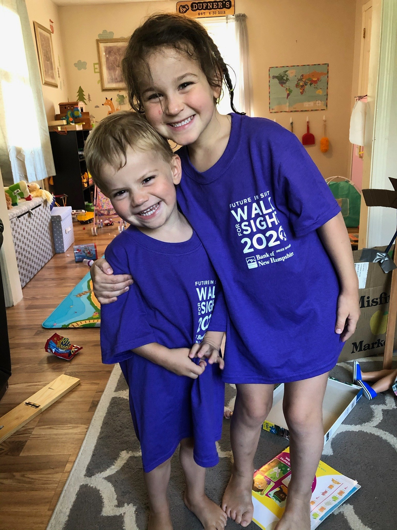 2 Smiling Children in their purple Walk for Sight 2020 t-shirts