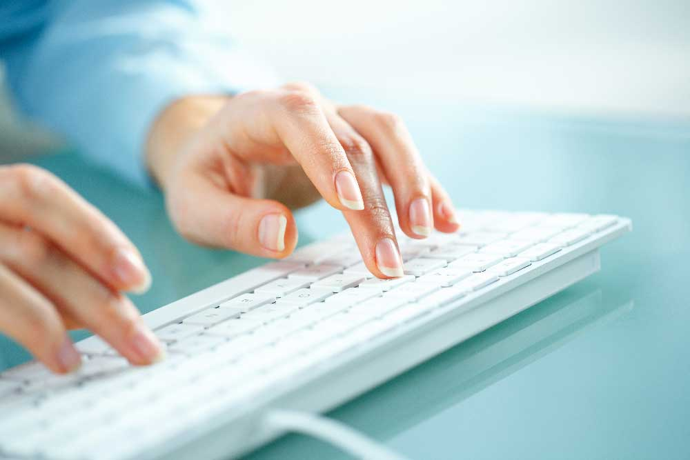 Keyboarding workshop - close up of a woman typing on a computer keyboard