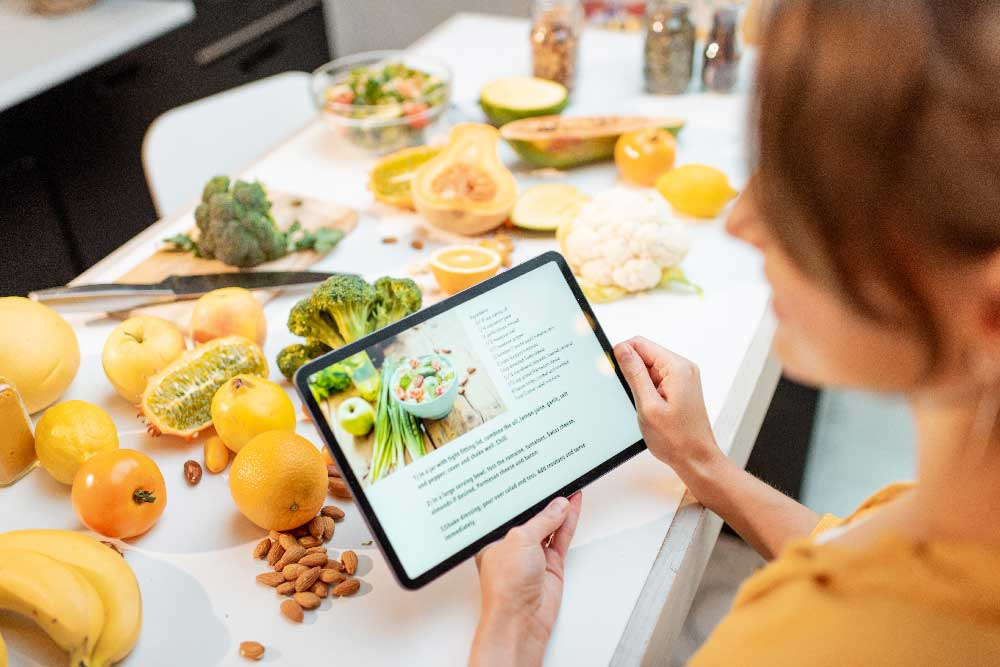 Woman using a recipe on a tablet