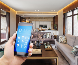 smart home technology - someone using a smart phone to control different areas of their home